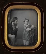 [Man Calming a Young Boy Posing before the Camera], ca. 1850.