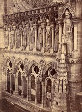 Pointed Arches, Sculptural Saints, and Rose Window on Unidentified Cathedral, 1880s.