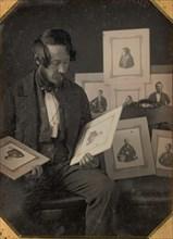 Frederick Langenheim Looking at Talbotypes, ca. 1849-51.