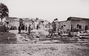 [Encampment with shacks and laundry]. Brady album, p. 129, 1861-65. Formerly attributed to Mathew B. Brady.