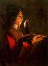 A young boy with a pipe, blowing on a firebrand (Le Souffleur à la pipe). Creator: La Tour, Georges de, (Circle) (1583-1652).