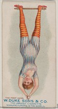The Foot Hang, from the Gymnastic Exercises series (N77) for Duke brand cigarettes, 1887., 1887. Creator: Unknown.