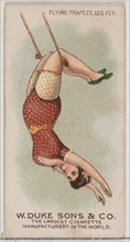 Flying Trapeze Leg Fly, from the Gymnastic Exercises series (N77) for Duke brand cigarette..., 1887. Creator: Unknown.