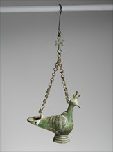 Hanging Lamp in the Form of a Peacock, Byzantine, 6th-7th century. The peacock became a Christian symbol in the 300s.