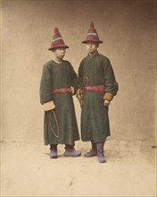 [Two Chinese Men in Matching Traditional Dress], 1870s.