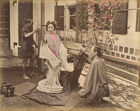 [Japanese Woman in Traditional Dress Posing with Two Men], 1870s.