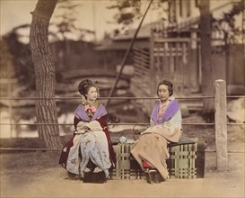 [Two Japanese Women Sitting on a Bench], 1870s.