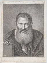 Portrait of a bearded man holding a book