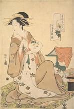 The Oiran Hinazuru of Chojiya Holding a Round Fan (Uchiwa)