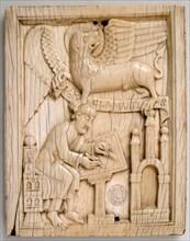 Evangelist Saint Mark writing the Gospel with his symbol