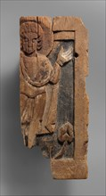 Fragmentary Carved Panel with a Saint
