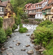 Some of the attractive, half-timbered medieval houses beside the Ruiver Weiss in the village of Kaysersberg, Alsace, France.