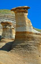 Hoodoos at the Badlands in Drumheller, Alberta, Canada, North America. Vertical format