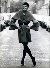 Aug. 04, 1982 - Here is a belted coat by Pierre Cardin with an original neckline. It is from his 1982-3 haute-couture fall and winter collection.