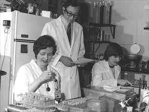 CDC Laboratorians. IMGSETINF, Lab technicians reading and checking serologies to determine presence of influenza A/NJ/8/76 (Swine Flu) and registering antibody rise to the swine influenza virus during...