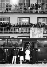 (dpa files) - People greet the ex-hostages as they arrive in a bus at the US military hospital in Wiesbaden, Germany, 21 January 1981. On 4 November 1979, 3,000 militants overran the U.S. Embassy in T...