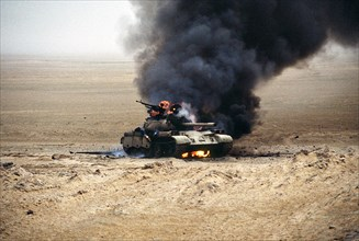 An Iraqi T-55 main battle tank burns after an attack by the 1st United Kingdom Armored Division during Operation Desert Storm February 28, 1991 in Kuwait.