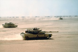 A US Army M-1A1 Abrams main battle tank from the 3rd Armored Division, moves across the desert into Kuwait during Operation Desert Storm February 15, 1991 in Kuwait.
