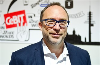 Hanover, Germany. 14th Mar, 2014. US American Internet entrepreneur and main founder of the online encyclopedia Wikipedia, Jimmy Wales poses at the computer fair CeBIT in Hanover, Germany, 14 March 20...