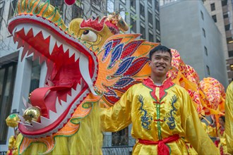 Dragon handler dressed in costume at San Francisco Chinese New Year parade.