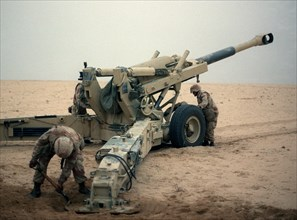 Marine artillerymen set up their M-198 155mm howitzer for a fire mission against Iraqi positions during Operation Desert Storm. U.S. Marines in the Persian Gulf War (1991) 001