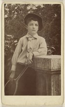 Young man wearing a beret, holding a tennis racket; American; about 1880; Gelatin silver print