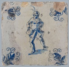 Figure tile, blue with dancing man with beret with plume on the head, corner motif, wall tile tile sculpture ceramic earthenware