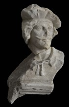 Male head with beret and goatee, sculpture footage limestone stone, sculpted Head of man with mustache goatee and beret.