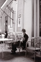 Street Cafe Newspaper Reader