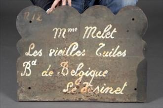 Rateau, Verso d'une plaque de cheminée