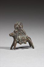 Statuette représentant probablement la Vierge Marie, lors de la fuite en Égypte