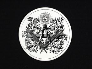 Jeton en porcelaine à décors maçonniques