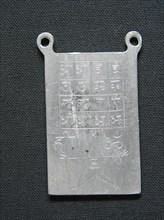 Amulette en plomb gravée de signes ésotériques