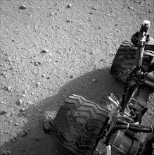 Soil clinging to the right middle and rear wheels of NASA's Mars rover Curiosity