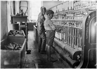 Doffers (Child labour) in a textile factory