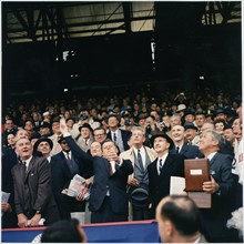 Colour photograph of President J F Kennedy throwing the first ball on opening day of the 1961 Baseball season