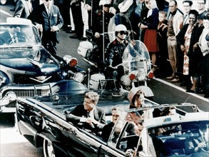 President John F Kennedy in the presidential limousine before his assassination