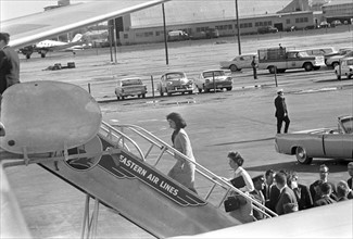 Photograph of the First Lady Jacqueline Kennedy boarding Air Force One