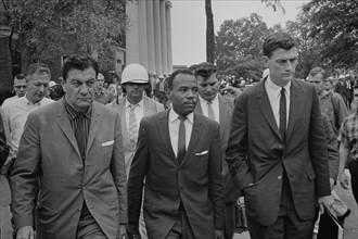 James Meredith (African-American student) walking to class following de-segregation,