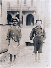 Young Italian immigrant boys employed as fruit sellers in Florida 1910.