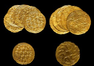Gold roundels depicting leaves in repose