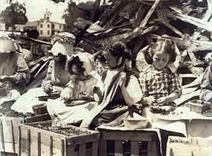 Group of child workers sorting fruit in the USA