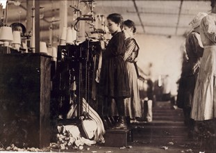 Photograph of a young girl employed as a knitter