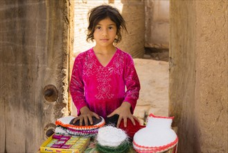Young girl sells goods in the streets of Yazd