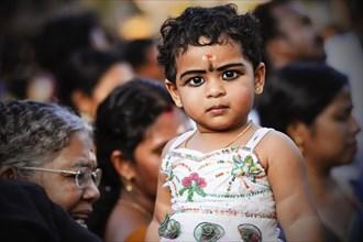 Girl at Hindu temple festival