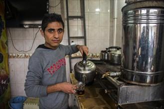 Boy selling tea