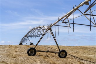Moving irrigation system standing on a dry stubble field in Alentejo