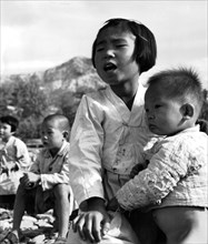 Korean war, young schoolgirl from Evur Pyung village, where school was completely razed to the ground during the war. 1950