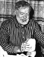 One of the last pictures of Ernest Hemingway (1899-1961) during a party at Sun Valley