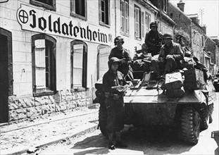 US Soldiers in front of a 'Soldatenheim' (June 1944)